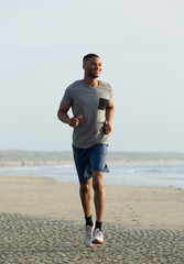 Young african american man smiling and running