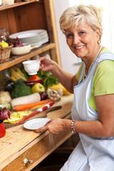 Senior woman  drinking coffee in her kitchen