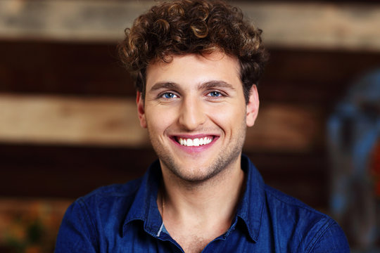 Portrait of a smiling handsome man with curly hair