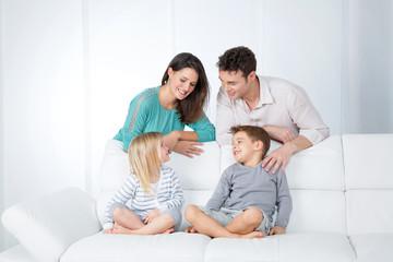 advertising family on sofa