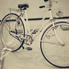 Vintage white bicycle parked