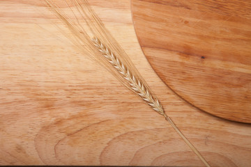 background of cutting boards spikelet of wheat