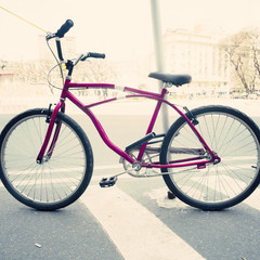 Vintage purple bicycle in the street