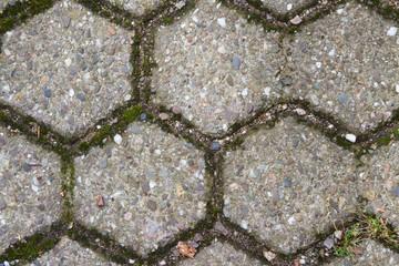 Detailaufnahme von Bodenbelag aus sechseckigen Pflastersteinen