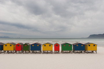 Brightly coloured beach huts 1