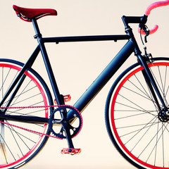 Black bicycle with red rims