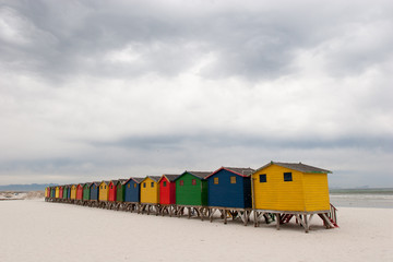 Brightly coloured beach huts 4