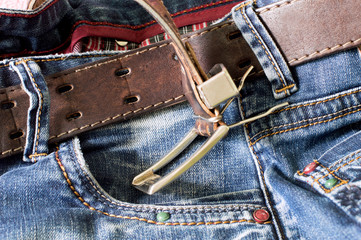 Textile: blue jeans with a brown leather belt