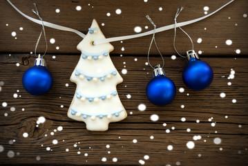 Christmas Tree and Christmas Balls Hanging on a Line on Wood