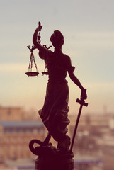 Themis or Lady Justice standing on window