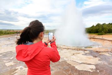 Iceland tourist taking photos of geyser Strokkur