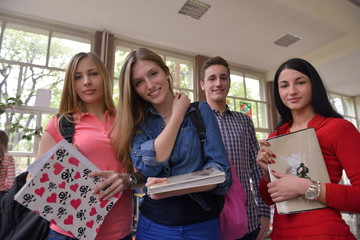 happy teens group in school