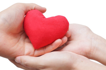 male hand giving a red heart to a female hand