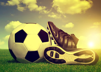 Vintage soccer background with ball and cleats