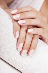 Fototapete - Beautiful woman's nails with french manicure.