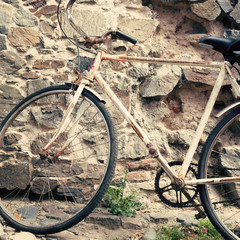 Old bicycle in a cobblestone street