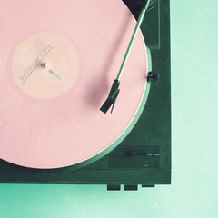 Vintage turntable with pink vinyl record