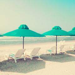 Vitnage green umbrellas in the beach