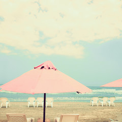 Pink umbrellas in summer beach