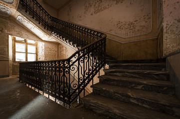 Abandoned staircase and hidden creepy hand Wall mural