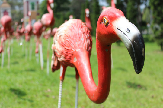 Red flamingos statue in the park.