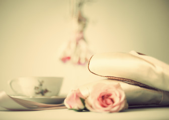 Vintage ballet shoes, roses and various objects