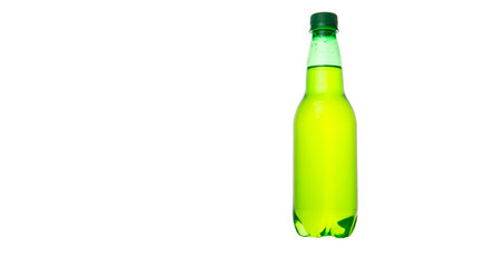 Green colored soda drinks in bottles over white background