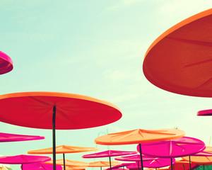 Colorful plastic umbrellas in the beach