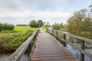 Wooden bridge in an autumnal landscape