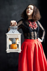 Young woman in photo studio on Halloween