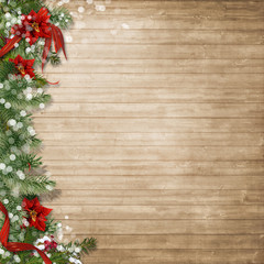 Christmas wood background  with poinsettia and firtree