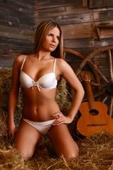 Woman in underwear on hay