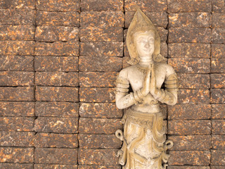 Thai angel guard on the  Laterite Stone Wall