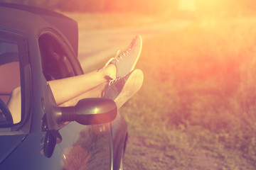 Woman's legs out of car windows