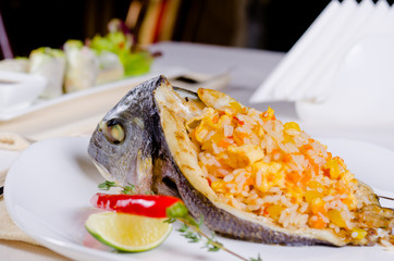 Appetizing Grilled Fish Stuffed with Rice Dish