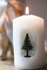 Christmas decoration - white candle with Christmas tree