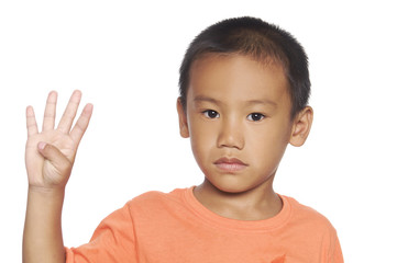 Cute boy and showing four finger
