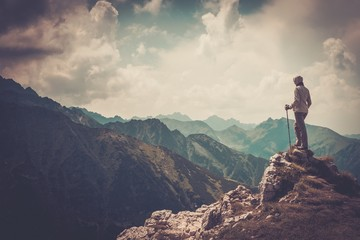 Woman hiker on a top of a mountain Wall mural