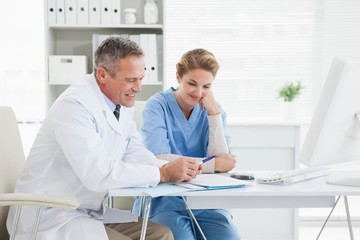 Doctor and nurse reading over medical notes