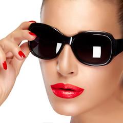 Beautiful Model in Black Fashion Sunglasses. Makeup and Manicure