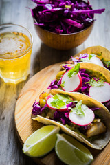 Fish tacoes on wooden background