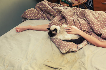 Woman and cat in bed