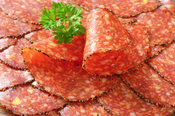 Black pepper-coated salami with cheese