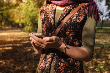 Woman using her phone in the park
