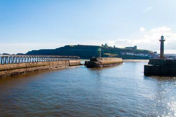 Scenic view of Whitby Pier in sunny day in North Yorkshire, UK.
