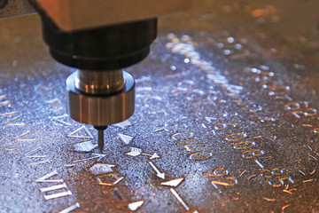 Machine for milling marks on metal