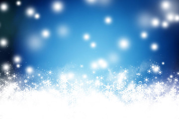 Abstract blue Christmas background with white snowflakes