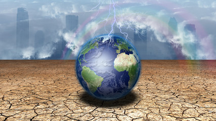 Earth sits in dried cracked mud before metropolis