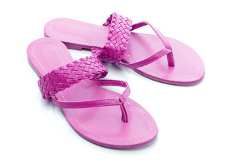 Pink flip flops on a white backgrond