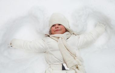 Happy cute little girl in winter park